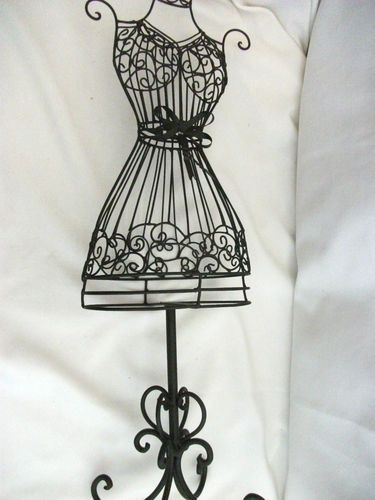metal wire dress form.... This is my tattoo with added lovelies ...