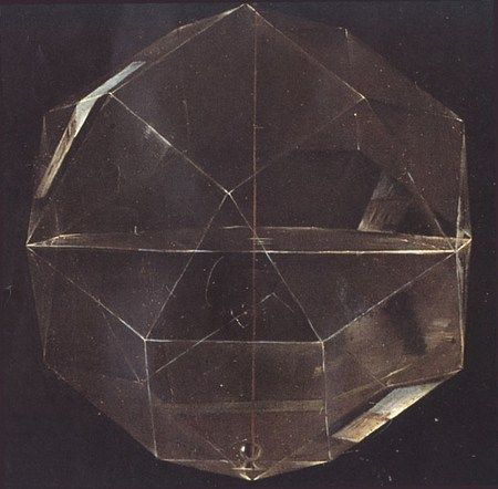 Detail showing rhombi-cuboctahedron in a painting of the mathematician Luca Pacioli by Jacopo de Barbari (1495)