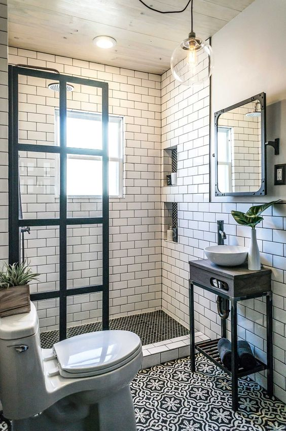 In this bathroom you have white subway tiles but you also have deep black grout. That helps to draw your attention to the grout lines, which is another way of adding some accent.