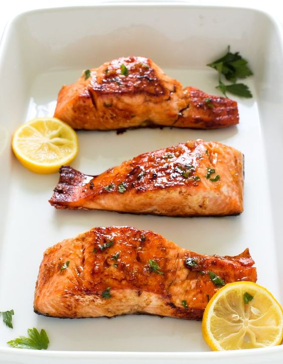 20 Minute Honey Garlic Salmon. Pan fried and served with a sweet and sticky honey lemon glaze. I've got the perfect dinner idea for a busy weeknight: This H
