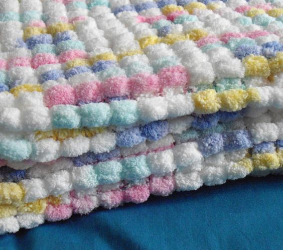 Knitting A Baby Blanket With Pom Pom Wool : Baby cot blanket pom wool by simplystitcheduk on etsy