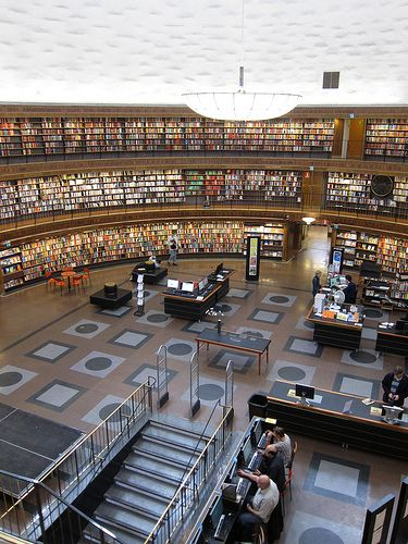 Stockholm Public Library open area circled by ranks of bookshelves, built 1924-1928, architect Gunnar Asplund, Sweden