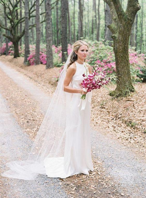 Cameran Eubanks In Wedding Dress Holding Purple Orchids Itgirlweddings Cameran