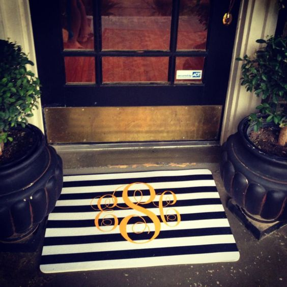 Accessories, : Rustic Home Decorating Ideas Of Front Porch Decoration Using White Black Stripes Mat Designed With Golden Pattern Combine With Single Glass Door With Black And Golden Frame Also Black Pots Of Plants In The Both Sides