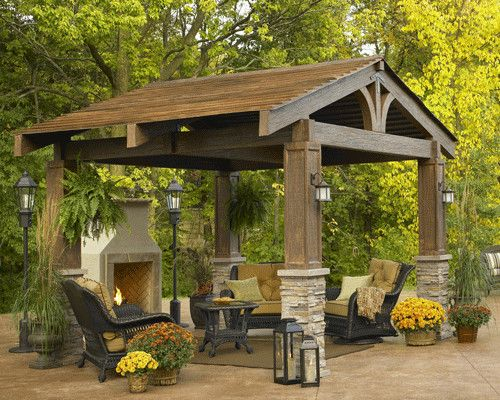 """""""The Lodge"""" -- This 10'x10 pergola has a natural, classic look with its split timber and curved beams. It's a beautiful, substantial way to add an additional outdoor room to the back yard. I love the stacked stone and the craftsman style lighting."""