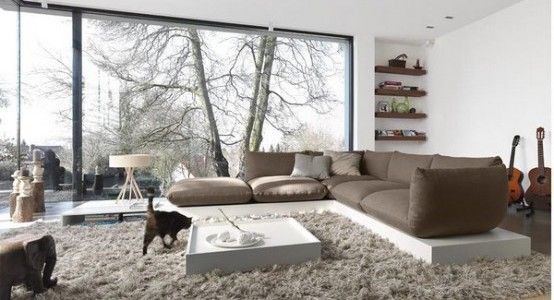 Cool White Living Room Wall With Brown Sofa Pillow Carpet Guitar Big Window Thrilling View 554x300