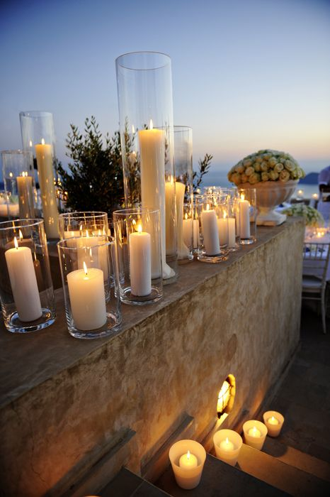 a must have on my big day-romantic lighting with candles and hurricane vases!, beautiful for beach wedding!