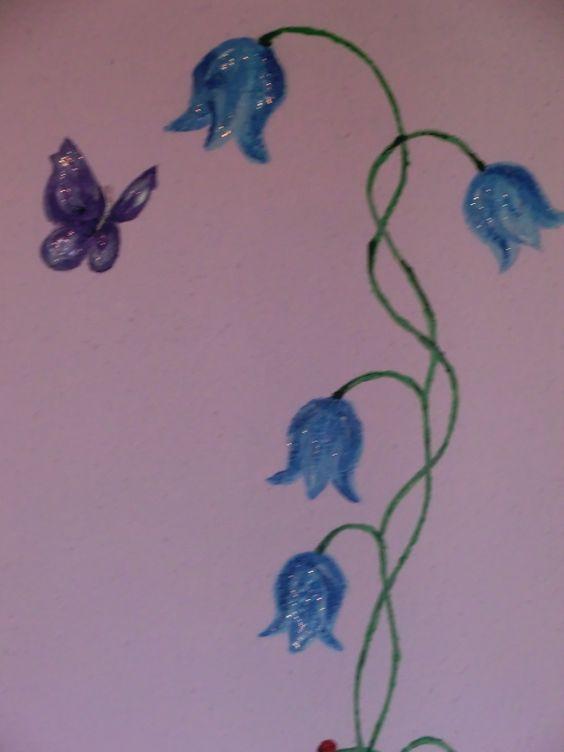 muurschildering, bloemen met vlinder - pimpelotje.nl