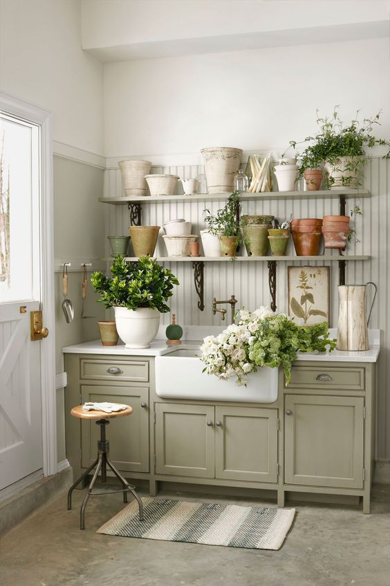 Perk up your backyard garden shed workspace by adding plenty of surfaces for cutting flowers and a sink for washing muddy hands.