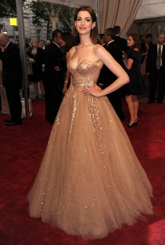 "Anne Hathaway attends the Costume Institute Gala Benefit to celebrate the opening of the ""American Woman: Fashioning a National Identity"" exhibition at The Metropolitan Museum of Art on May 3, 2010 in New York City. Couture: Valentino."