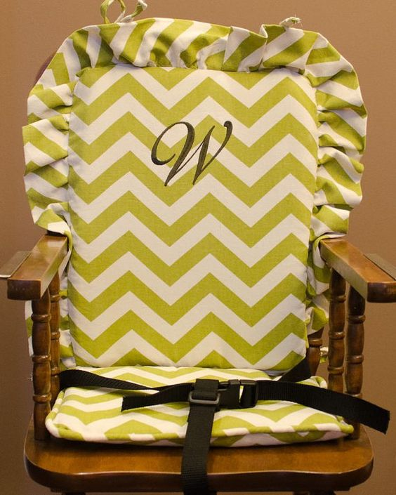 Thinking I could make something like this and attach straps to the cover instead of the wood Wooden Highchair Cover:  Green Chevron cushion for wooden/vintage highchairs.  Removable foam for easy washing.  Optional monogramming.