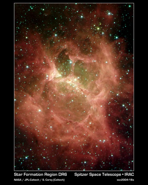 """DR 6 nebula (""""Galactic Ghoul""""). This is a star-forming region in the constellation Cygnus, with the central region (the """"nose"""") about 3.5 light years across. The nebula's nickname comes from its resemblance to a ghoulish face, with cavities in the cloud looking rather like two eyes and a devouring mouth. (Credit: S. Carey (Caltech), JPL-Caltech, NASA) Mona Evans, """"Cosmic Ghosts Ghouls and Vampires"""" http://www.bellaonline.com/articles/art181890.asp: Space The Final, Final Frontier, Infrared Eyes, Newborn Stars, Favorite Spaces, Galactic Ghoul"""