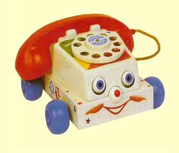 Yes! Mine had a string where you pulled it around and it made dinging noises and the eyes blinked. Good ol' toy roatary phones.: