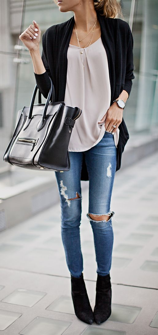 Christine Andrew is wearing a tank top from Ro & De, cardigan from H by Bordeaux, jeans from AG Adriano and the tote is from Celine