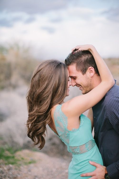 I love everything about this picture especially her hair. engagement photos