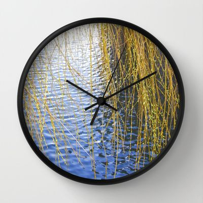 """""""Ripples""""Available in natural wood, black or white frames, $30.00 - our 10"""" diameter unique Wall Clocks feature a high-impact plexiglass crystal face and a backside hook for easy hanging. Choose black or white hands to match your wall clock frame and art design choice. Clock sits 1.75"""" deep and requires 1 AA battery (not included). #clock #wall #ripples #homedecor #water"""
