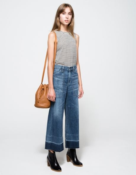 From Citizens of Humanity, mid-rise wide-leg cropped jeans in retro mid-blue wash. Features zipper fly with branded top button, belt loops, whiskering and faded detailing throughout, deep boxy front pockets, back pockets, hem wash detail, unravel hem and
