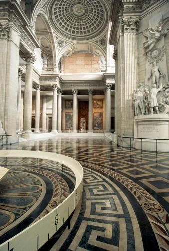 A view of the ornate marble corridors inside the Pantheon, which acts as a national mausoleum and is an example of neo-classical architecture.