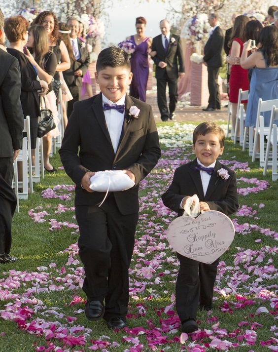 If you have a few adorable kids in your family, chances are you've already selected your flower girl and ring bearer. But if you have a bevy of little ones you'd like to include in your ceremony, it can be tough to figure out what roles they can each play. Older kids may enjoy handing out programs or serving as junior bridesmaids and groomsmen, but these types of jobs may be overwhelming for the younger set.  A charming alternative is to ask one or two kids&...: