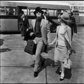 BeatlesJohn Lennon (1940 - 1980) of the Beatles at London Airport with his wife Cynthia, 24th May 1965. (Photo by Evening Standard/Hulton Archive/Getty Images)