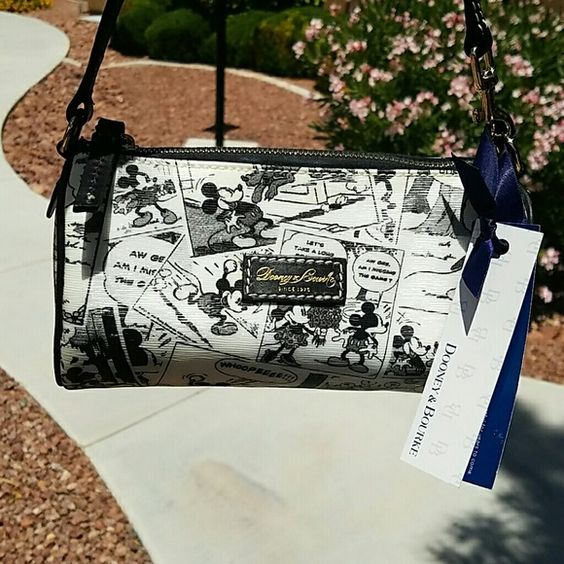 """NWT Dooney & Bourke Disney Comic Purse Authentic small Dooney & Bourke black and white Disney character """"mini barrel"""" purse. (D517l BL 63921584) Brand new with tags. Purchased in California @ Disneyland. Red inside with an inner zipper pocket, open pouch, and black leather key strap. Please note- on one of the sides at the top there is a small yellowish spot, but it is hardly noticeable..I only noticed it when i took photos outside and looked at it real close! Comes from a smoke free home…"""