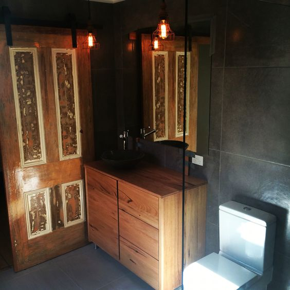Ensuite bathroom incorporating natural timber and stone. A modern rustic design