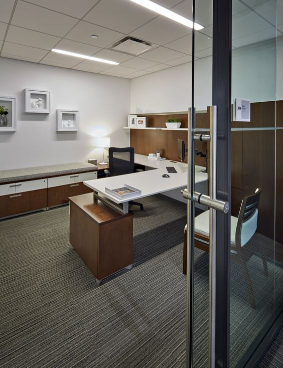 This private office features Epic casegoods and storage with Mix-It task seating and Acquaint guest seating. The lower storage unit in the back has a cushion for guests to perch and the woodgrain Exhibit Wall Rail Solution with shelf insert give the space additional storage and warmth. #NationalOffice #NationalHQ #FurnitureWithPersonality