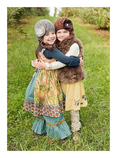 Ph... I love their outfits, especially the one on the left.  Where can I get one for my little girl!?