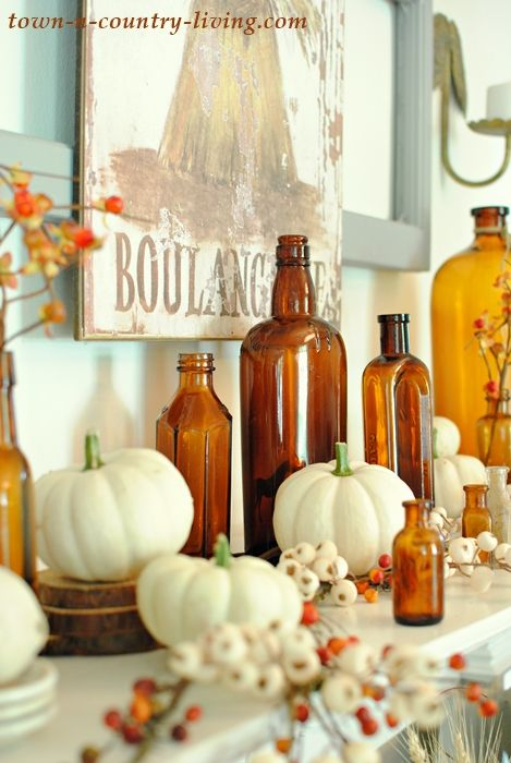 See how to create a vintage fall mantel using your favorite collectibles. Add a bit of colorful fall foliage to finish the look!