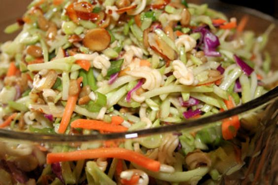 Love this salad..Oriental Ramen Broccoli Cole Slaw 2 (3 ounce) packages beef-flavor ramen noodles 2 (8 1/2 ounce) packages broccoli coleslaw mix 1 cup toasted slivered almond 1 cup sunflower seed 1/2 bunch green onion , chopped 1/2 cup sugar 3/4 cup oil 1/3 cup white vinegar