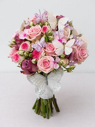 Butterflies adorn this beautiful rose wedding bouquet