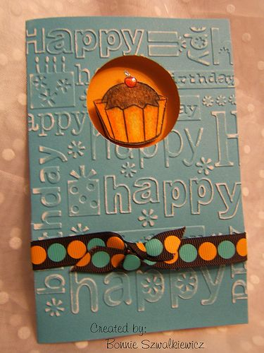 Cuttlebug embossed greeting card w/springy cupcake
