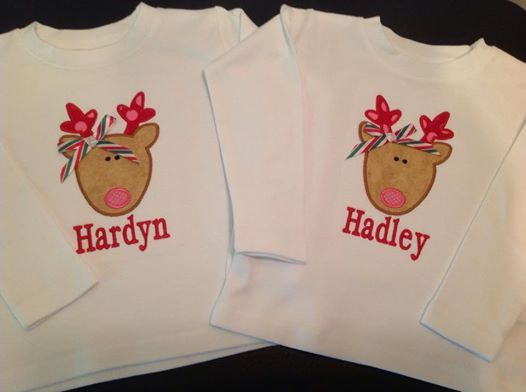Christmas Reindeer with Bow is appliqued directly onto a super soft white bib, bodysuit or t-shirt with your child's name embroidered directly below the applique in your choice of font style. Choose from boy's crew neck t-shirt or girl's lettuce edge t-shirt. Choose your favorite font style here .  Leave information in boxes below.