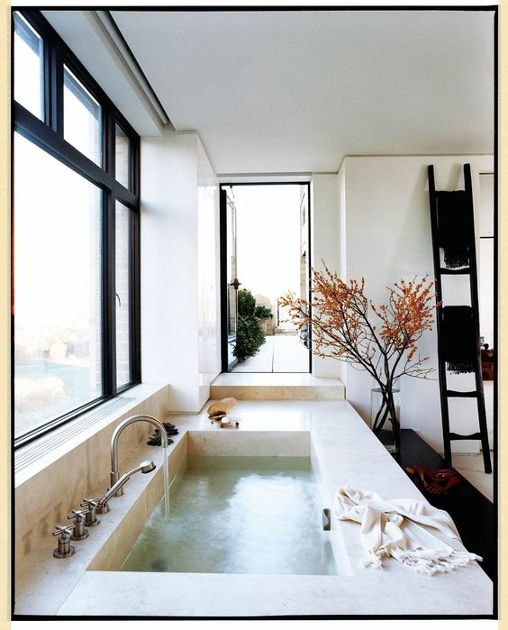The travertine master bath commands dramatic views of the north terrace and vistas of Central Park.
