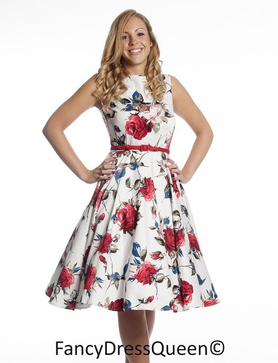 A beautiful floral summer dress that includes the red belt in an ...
