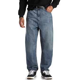 Jeans. A pair of roomy, loose fit jeans with slightly tapered legs that look great with sneakers or other casual shoes. Sit at the waist for a classic fit Tapered legs offer a fashionable look Relaxed, roomy fit through the hips and thighs Classic five-pocket styling Cotton Imported