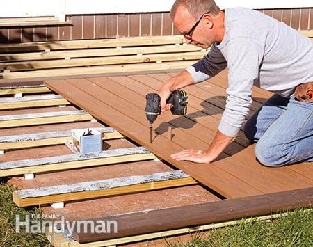Fasten the deck boards to the sleepers on the concrete patio.