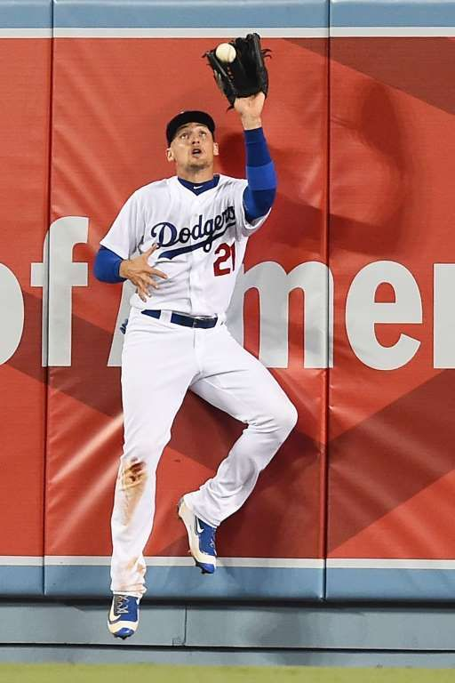 Backed up to the wall:    Trayce Thompson of the Los Angeles Dodgers makes a catch at the wall off Brandon Barnes of the Colorado Rockies in the fifth inning of the game at Dodger Stadium on July 1, in Los Angeles, Calif.
