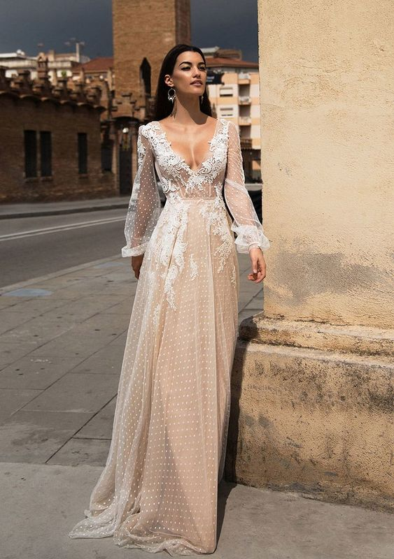 wedding dresses with delicate details and extravagant silhouettes