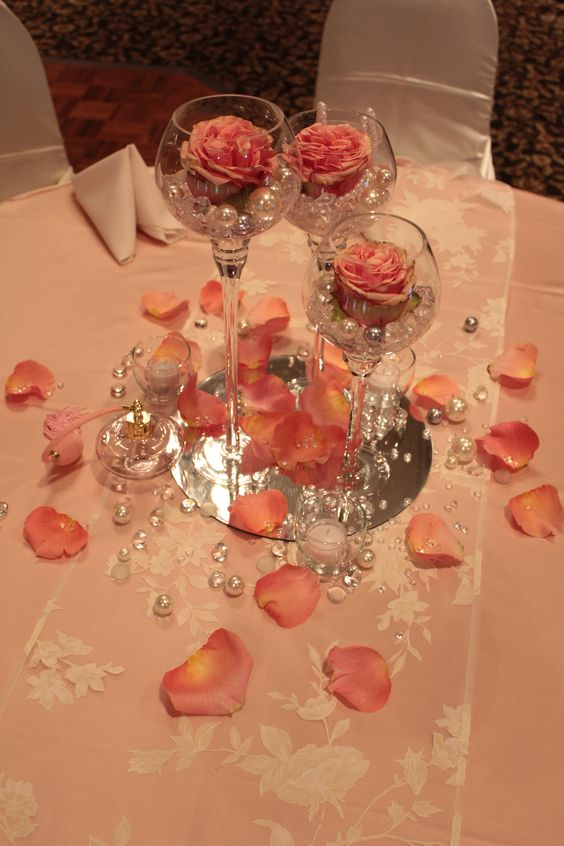 Elite Trio Centerpiece with fresh roses accented with pearls and diamonds.: