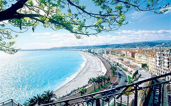 Looking west along Nice's wide beach and Promenade des Anglais.