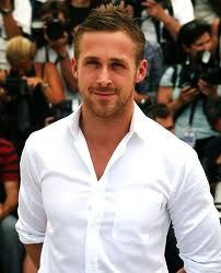 Ryan Gosling casual in a white button-down shirt.