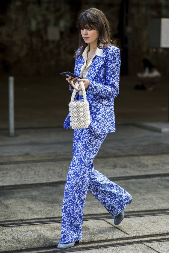 A printed trouser suit has the unexpected panache to keep office-wear interesting. Wear over a fine silk shirt to avoid overheating.