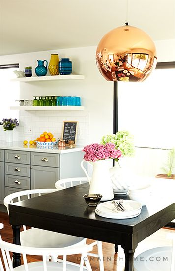 Before and After: A Dramatic DIY Makeover // Tom Dixon copper globe pendant, black dining table, white dining chairs, gray kitchen cabinets, open shelving
