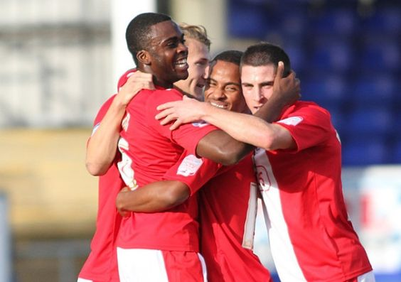 Hope Akpan is mobbed after scoring for Crawley-Pic by:Richard Parkes  http://www.crawleyobserver.co.uk/sport/crawley-town-fc/hartlepool-utd-0-crawley-town-1-akpan-hits-reds-winner-1-4393867#