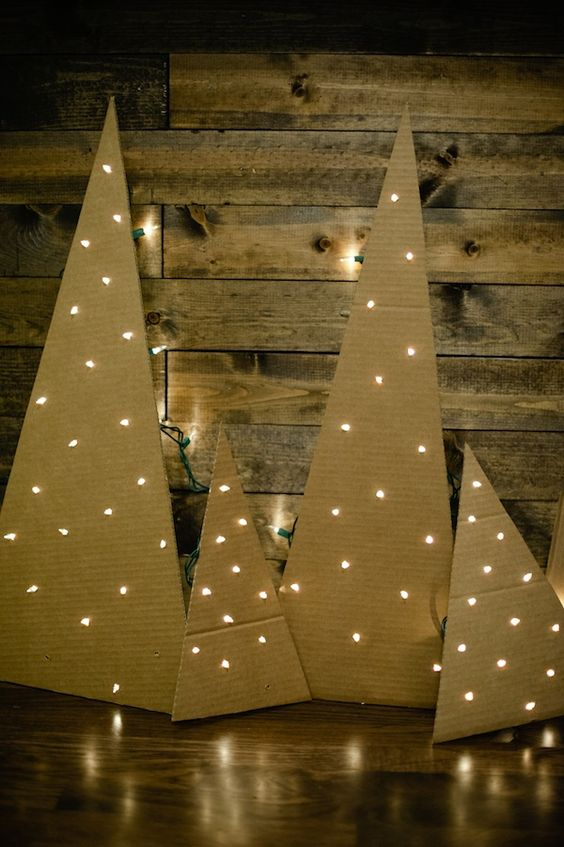 cardboard christmas trees with mini lights.: