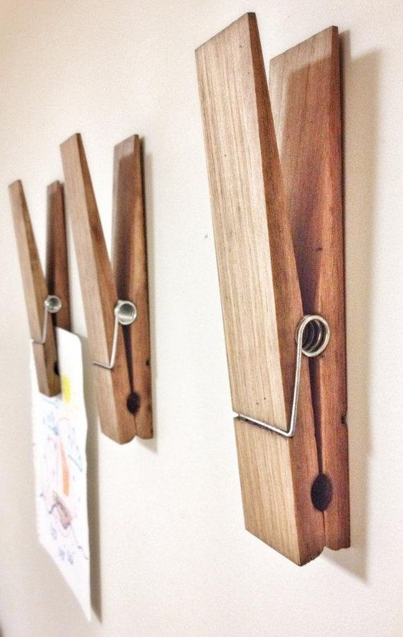 These massive wooden clothespins can hold artwork, photographs or reminders, and you can have them customized with a name or word of your choice. #etsy