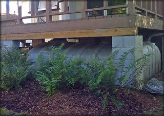 Modern Cisterns & Rain Harvest Technology, hidden under the back deck.  I love this solution.: