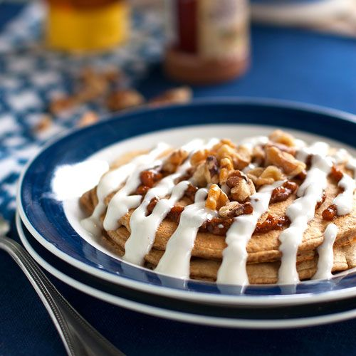 Healthy Cinnamon Roll Pancakes by pinchofyum: Made with bran cereal, buttermilk, egg whites, pumpkin puree, cinnamon, brown sugar, walnuts, Greek yogurt and honey! #Pancakes #Healthy #Cinnamon_Roll #pinchofyum