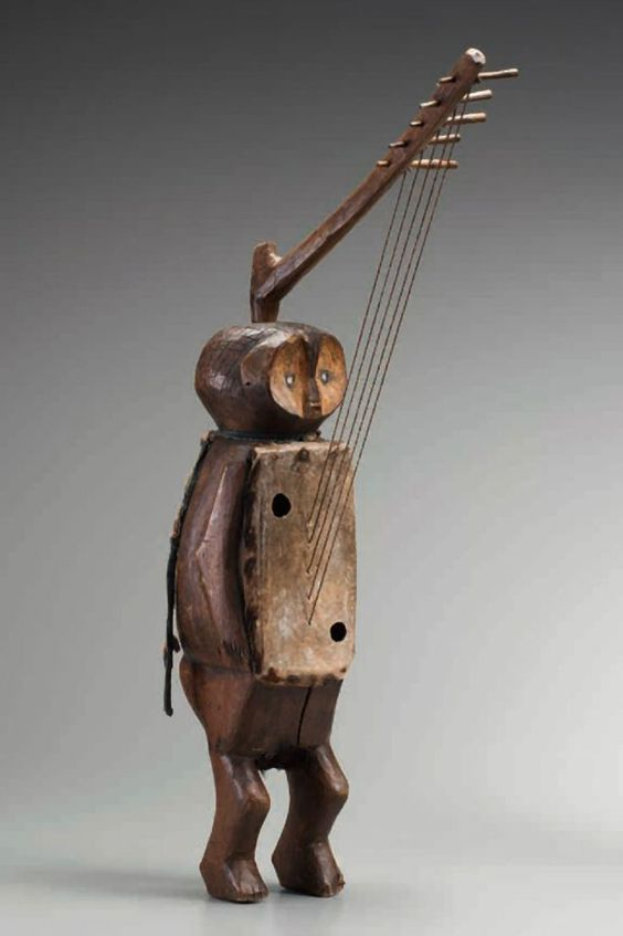 Africa | Bow harp from the Banda Togbo people of DR Congo | Wood, skin, glass, metal and plant fiber | 19th to 20th century. this one look like a guitar, the usually used that in rituals.: